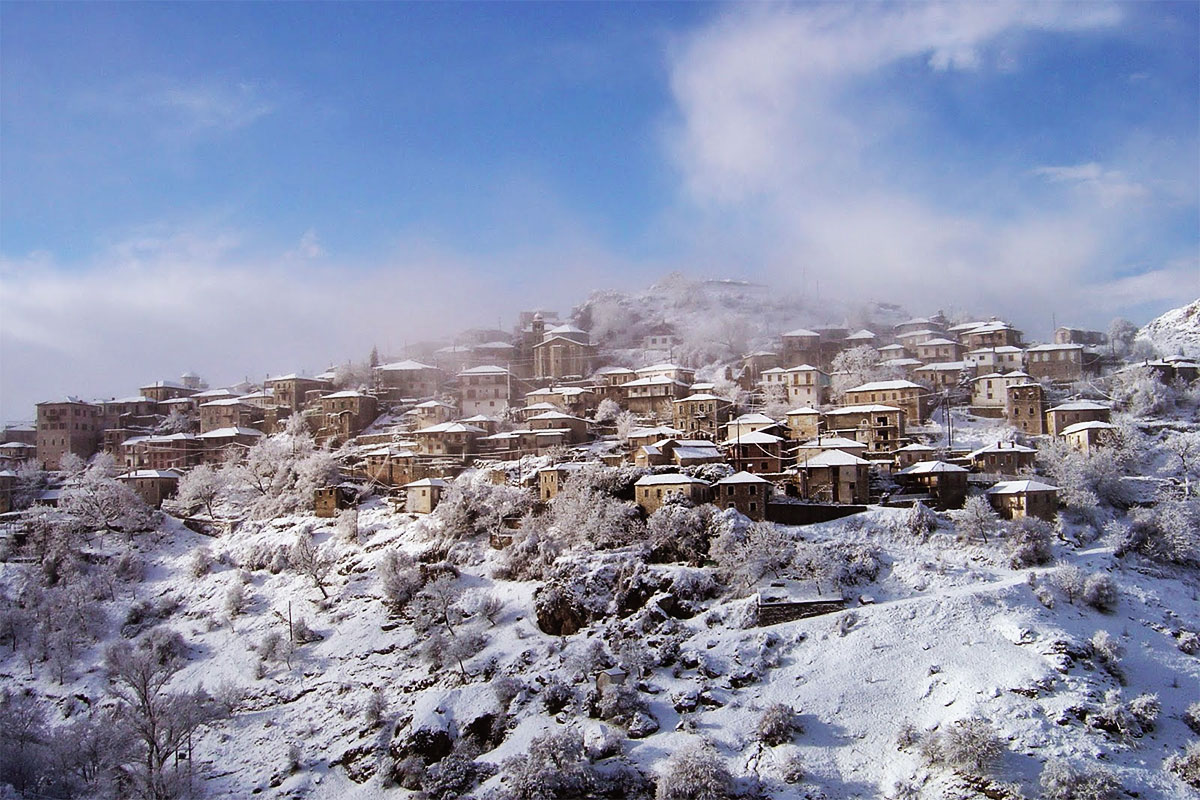Snowy and sunny, the settlement of Dimitsana